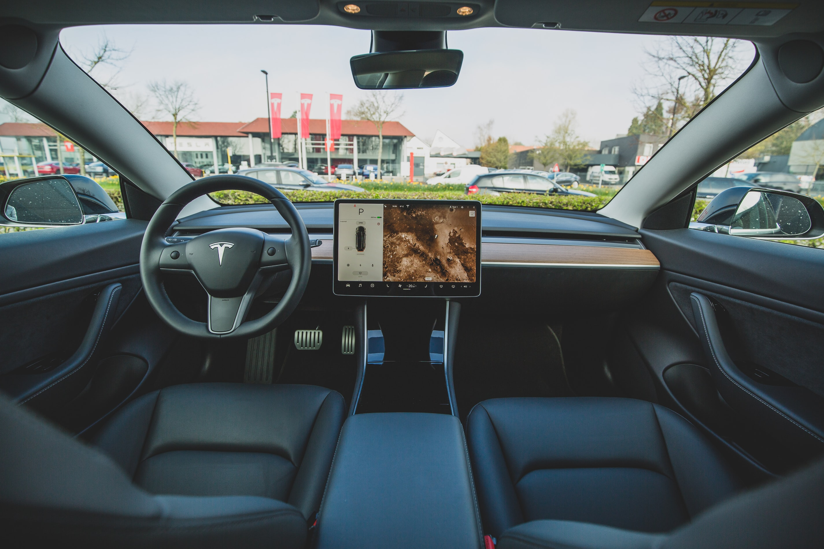 interior of a tesla, as viewed from the driver's seat